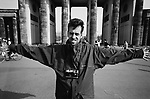 Photographer Colin McPherson beside the Brandenburg Gate, two years after the Berlin Wall came down. The Berlin Wall was a barrier constructed by the German Democratic Republic (GDR, East Germany) starting on 13 August 1961, that completely cut off West Berlin from surrounding East Germany and from East Berlin. The Wall was opened on 9. November 1989 allowing free movement of people from east to west.