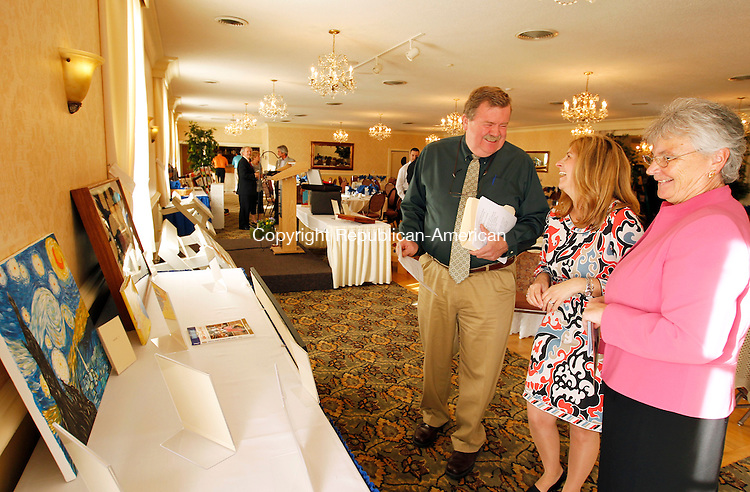 Torrington, CT-10, April 2010-041010CM08  Craig Schroeder, Kim O'Meara (middle) and Patricia Devanney (Principal at St. Anthony's School in Winsted), enjoy a laugh while looking at silent auction items Saturday evening at the Cornucopia Banquet Hall in Torrington.  St. Anthony's School held it's 8th annual auction and dinner dance Saturday evening.  The event is held to raise 30,000 for the school, which is used fort operating costs and help keep tuition low. A lot of the items were donated by the different grades from the school and included a handmade quilt, game cube (which had board games inside), and custom painted picnic tables. --Christopher Massa Republican-American