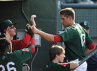 Third baseman Garin Cecchini (17) of the Greenville Drive is congratulated after scoring a run in a game against the Rome Braves on May 6, 2012, at Fluor Field at the West End in Greenville, South Carolina. Cecchini is the No. 7 prospect for the Boston Red Sox, according to Baseball America. Greenville won, 11-3. (Tom Priddy/Four Seam Images)