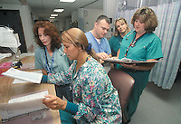 Nurses at work in a hospital Surgical Intensive Care Unit.