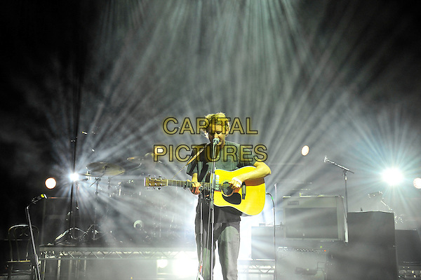 Ben Howard <br /> performing in concert, Hammersmith Apollo, London, England. <br /> 12th June 2013<br /> on stage live gig performance music half length 3/4 black t-shirt guitar singing <br /> CAP/MAR<br /> &copy; Martin Harris/Capital Pictures