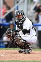 Jamestown Jammers catcher Deybi Garcia (7) looks to the dugout during a game against the Mahoning Valley Scrappers on June 16, 2014 at Russell Diethrick Park in Jamestown, New York.  Mahoning Valley defeated Jamestown 2-1.  (Mike Janes/Four Seam Images)