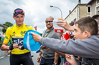 Picture by Alex Whitehead/SWpix.com - 11/07/2017 - Cycling - Le Tour de France - Stage 11, Eymet to Pau - Chris Froome of Team Sky signs autographs for fans before the start.