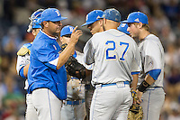 UCLA head coach John Savage points to the bullpen calling for a relief pitcher in the eighth inning against the North Carolina State Wolfpack during Game 8 of the 2013 Men's College World Series on June 18, 2013 at TD Ameritrade Park in Omaha, Nebraska. The Bruins defeated the Wolfpack 2-1, eliminating North Carolina State from the tournament. (Andrew Woolley/Four Seam Images)