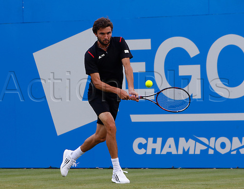 15.06.2016. Queens Club, London, England. Aegon Queens Tennis Championships Day Three.  Gilles Simon (FRA) his a backhand in his 1st round match against Kyle Edmund (GBR).
