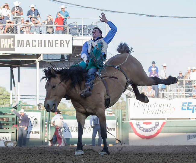 Jesse Pope rides in the Bareback Bronc Riding event during the Reno Rodeo on Sunday, June 23, 2019.