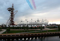 Olympics - London 2012 Olympic Games - Opening Ceremony - Olympic Park, Stratford, London - 27/7/12..General view of the Red Arrows flying over the Olympic Stadium during the Opening Ceremony..Mandatory Credit: Action Images / Matthew Childs..Livepic