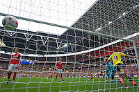 Kemar Roofe of Oxford United celebrates after Callum O'Dowda of Oxford United scores the opening goal with a header past goalkeeper Adam Davies of Barnsley during the Johnstone's Paint Trophy Final match between Oxford United and Barnsley at Wembley Stadium, London, England on 3 April 2016. Photo by Alan  Stanford / PRiME Media Images.