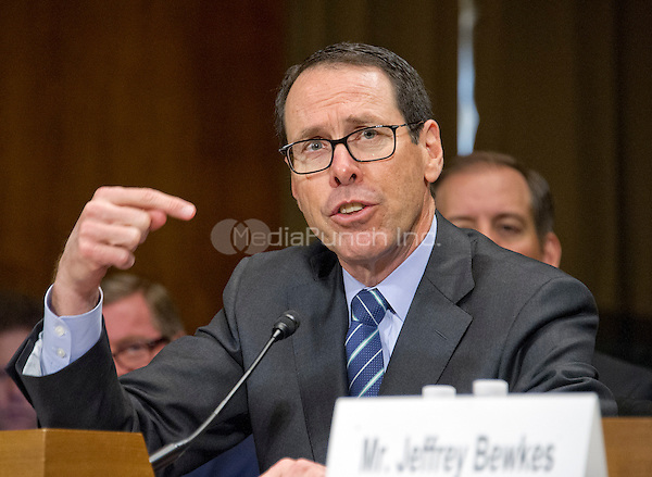 """Randall Stephenson, Chairman & Chief Executive Officer<br /> AT&T, gives testimony before the United States Senate Committee on the Judiciary Subcommittee on Antitrust, Competition Policy & Consumer Rights during the hearing """"Examining the Competitive Impact of the AT&T-Time Warner Transaction"""" on Capitol Hill in Washington, DC on Wednesday, December 7, 2016.<br /> Credit: Ron Sachs / CNP /MediaPunch"""