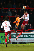 Ben Wilmot of Stevenage rises with Modou Barrow of Reading during Stevenage vs Reading, Emirates FA Cup Football at the Lamex Stadium on 6th January 2018