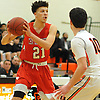 Sean Braithwaite #21 of Center Moriches, left, looks for an open teammate during a Suffolk County League VII varsity boys basketball game against host Babylon High School on Friday, Jan. 26, 2018. Center Moriches won by a score of 84-80.