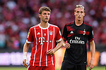 Bayern Munich Forward Thomas Muller (L) in action during the 2017 International Champions Cup China match between FC Bayern and AC Milan at Universiade Sports Centre Stadium on July 22, 2017 in Shenzhen, China. Photo by Marcio Rodrigo Machado/Power Sport Images