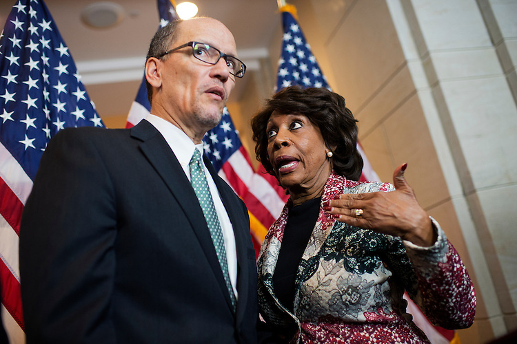 UNITED STATES - APRIL 28: Labor Secretary Thomas Perez and Rep. Maxine Waters, D-Calif., attend a news conference in Capitol Visitor Center on the fiduciary rule which is meant to help Americans save for retirement, April 28, 2016. (Photo By Tom Williams/CQ Roll Call)
