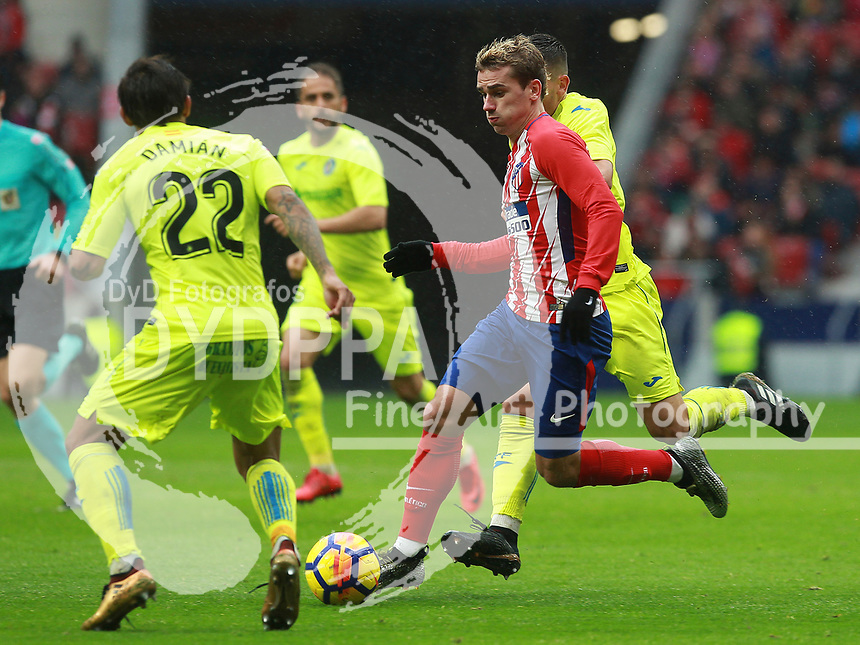 Atletico Madrid's French forward Antoine Griezmann; Getafe's player Damian Suarez<br /> Atletico de Madrid vs Getafe Spanish League football match, La Liga Santander, at Wanda Metropolitano stadium in Madrid on January 6, 2017