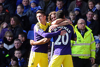 Pictured: Jonathan de Guzman of Swansea (R) with team mates Pablo Hernandez and Jose Canas celebrating his equaliser making the score 1-1. Sunday 16 February 2014<br />