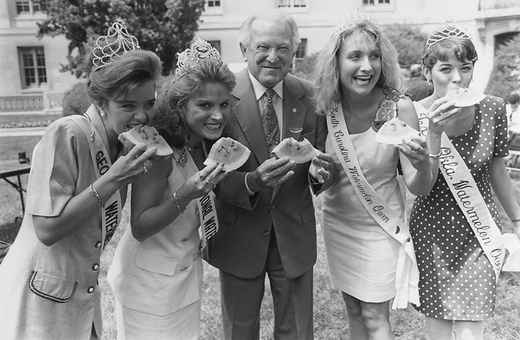 Left to right: Crystal Bolders from Georgia, Susan Edens from North Carolina, Rep. Floyd Spence, R-S.C., Audra Grant from South Carolina, and Addrianne Rhone from Texas.  During Watermelon Feast Day at Russell Courtyard on July 14, 1994. (Photo by Chris Martin/CQ Roll Call via Getty Images)