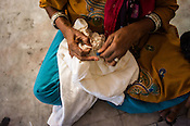 A woman is seen sowing fabric at a batik workshop in Jaipur, Rajasthan, India.