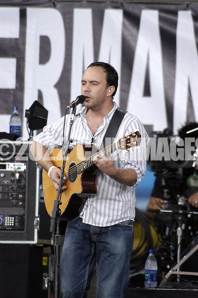 """PHILADELPHIA - JULY 02:  Singer Dave Matthews performs on stage at """"Live 8 Philadelphia"""" at the Philadelphia Museum of Art July 2, 2005 in Philadelphia, Pennsylvania. The free concert is one of ten simultaneous international gigs including London, Berlin, Rome, Paris, Barrie, Tokyo, Cornwall, Moscow and Johannesburg. The concerts precede the G8 summit (July 6-8) to raising awareness for MAKEpovertyHISTORY.  (Photo by William Thomas Cain/Getty Images)"""