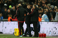 Manchester United manager Ole Gunnar Solskjaer and Tottenham Hotspur manager Mauricio Pochettino after Tottenham Hotspur vs Manchester United, Premier League Football at Wembley Stadium on 13th January 2019