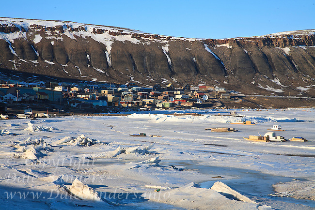 Community of Arctic Bay near the north end of Baffin Island in Nunavut, Canada. This is the middle of May and it will still be several months before the ice will leave the inlet, so snowmobiles and komatik sleds are still the main source of transportation around the high arctic.