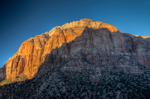 The sun sets on the towering East temple at Zion National Park, Utah