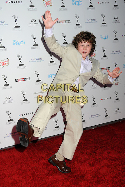 NOLAN GOULD .62nd Primetime Emmy Awards Nominee Reception held at the Pacific Design Center, West Hollywood, California, USA..August 27th, 2010.full length suit gesture kick kicking leg up beige white funny.CAP/ADM/BP.©Byron Purvis/AdMedia/Capital Pictures.