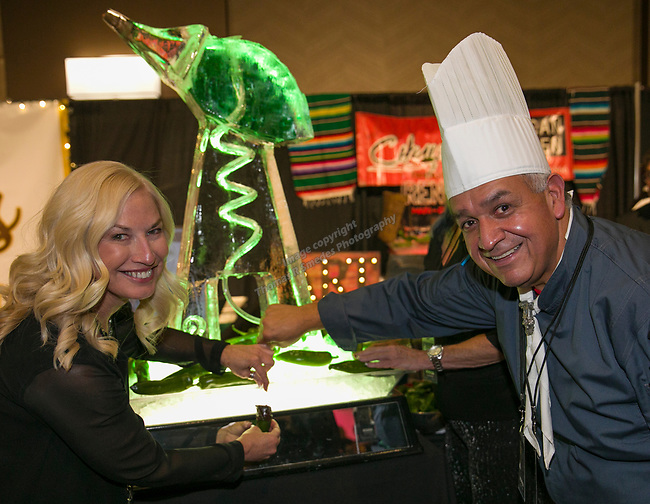 """Chef Jesus """"Chuy"""" Gutierrez, right, helps Debbie McCarthy with a tequilla drink during Fantasies in Chocolate at the Grand Sierra Resort on Saturday night, November 17, 2018."""