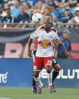 New York Red Bulls forward Dane Richards (19) attempts to control the ball as New England Revolution defender Chris Tierney (8) pressures. In a Major League Soccer (MLS) match, New England Revolution defeated New York Red Bulls, 2-0, at Gillette Stadium on July 8, 2012.