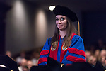 Madeleine Wineland stands to be recognized as a recipient of a Student Service Award during the DePaul University College of Law commencement ceremony, Sunday, May 14, 2017, at the Rosemont Theatre in Rosemont, IL, where some 240 students received their Juris Doctors or Master of Laws degrees. The Rev. Dennis H. Holtschneider, C.M., president of DePaul, conferred the degrees. (DePaul University/Jeff Carrion)