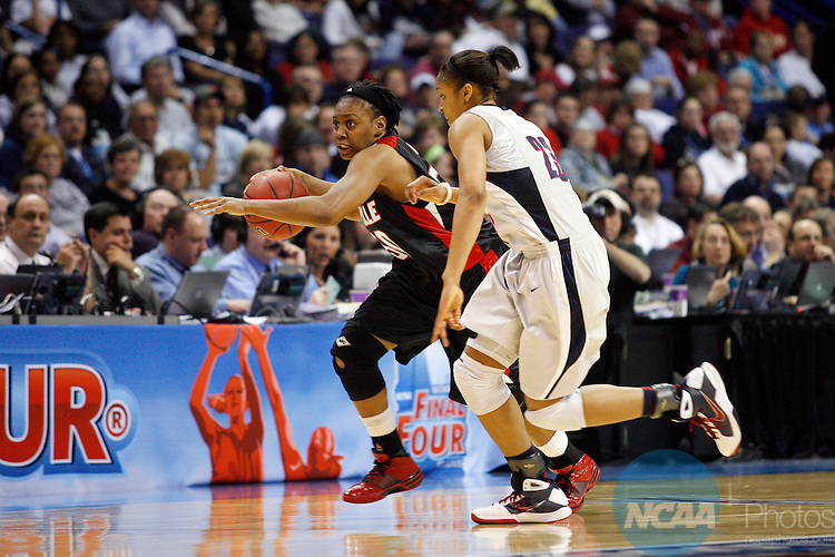 07 APR 2009:  Maya Moore (23) of the University of Connecticut pressures Deseree' Byrd (50) of the University of Louisville during the Division I Women's Basketball Championship held at the Scottrade Center  in St. Louis, MO.  Connecticut defeated Louisville 76-54 for the national title.  Jamie Schwaberow/NCAA Photos