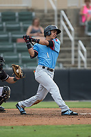 Anderson Tejeda (1) of the Hickory Crawdads follows through on his swing against the Kannapolis Intimidators in game one of a double-header at Kannapolis Intimidators Stadium on May 19, 2017 in Kannapolis, North Carolina.  The Crawdads defeated the Intimidators 5-4.  (Brian Westerholt/Four Seam Images)