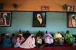 A group of women sit in the audience room at the palace of the Emir of Katsina during a visit to the emir by singer Natalie Imbruglia to thank him for his support of the UNFPA's campaign to end fistula. Imbruglia and UNFPA, the United Nations Population Fund, are working to bring awareness to obstetric fistula, a devastating injury of childbirth that affects more than two million women in developing countries, particularly Nigeria where half of known cases are found. The condition, caused by damage to the walls of the vagina during protracted labor, usually leads to the death of the child and leaves affected women incontinent and often disowned by their husbands and communities.