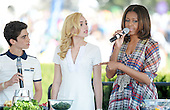 United States first lady Michelle Obama (R) makes a healthy drink with comedian Peyton List and Cameron Boyce(L)  from the comedy series Jessie during the annual White House Easter Egg Roll on the South Lawn of the White House April 21, 2014 in Washington, DC. President Barack Obama and first lady Michelle Obama hosted thousands of people during the annual celebration of Easter. <br /> Credit: Olivier Douliery / Pool via CNP