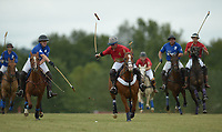 NWA Democrat-Gazette/ANDY SHUPE<br /> Josh Shelton (center) drives the ball up the field Saturday, Sept. 8, 2018, ahead of John Hand (left) during the 29th annual Polo in the Ozarks at the Buell Farm in Goshen. This event features a polo match, games, vendors, music and food to benefit Life Styles Inc.