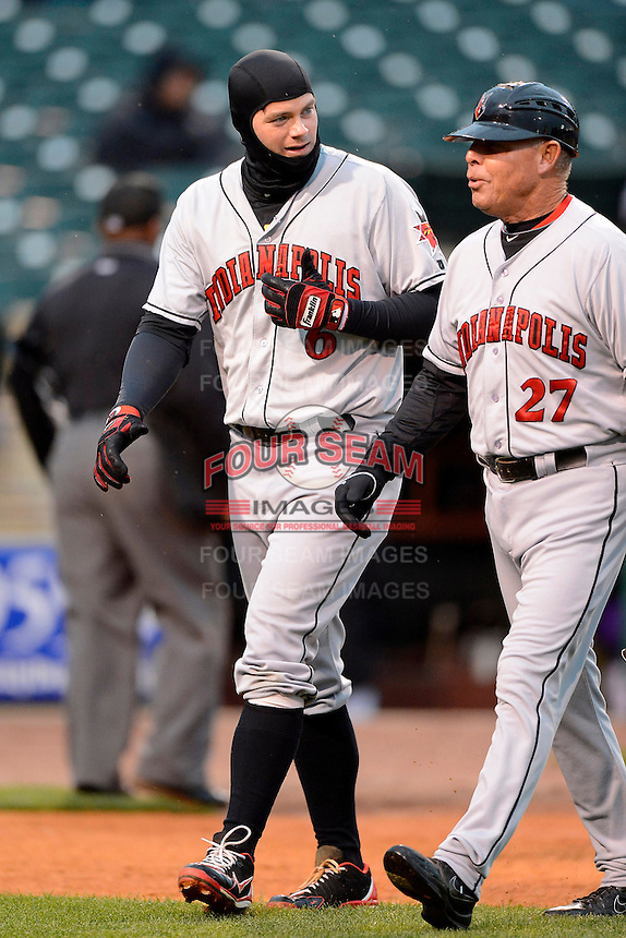 Indianapolis Indians first baseman Matt Hague #6 walks off the field with manager Dean Treanor #27 during a game against the Louisville Bats on April 19, 2013 at Louisville Slugger Field in Louisville, Kentucky.  Indianapolis defeated Louisville 4-1.  (Mike Janes/Four Seam Images)