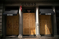 NEW YORK, NY - APRIL 20: The Store Guess is seen covered with plywoods due to COVID-19 pandemic on April 20, 2020. in New York City. United States. U.S. President Trump is looking to get many Americans back to work as soon as possible, but also he recognizes that cities like New York will need to go slow. (Photo by Eduardo MunozAlvarez/VIEWpress)