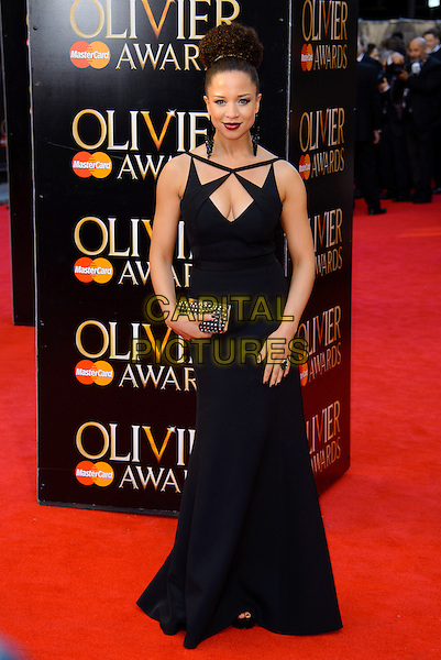 LONDON, ENGLAND - APRIL 13: Natalie Gumede attends the Olivier Awards 2014 at the Royal Opera House on April 13, 2014 in London, England. <br /> CAP/CJ<br /> &copy;Chris Joseph/Capital Pictures