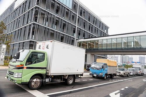 Trucks transport merchandise at the new Tokyo Metropolitan Central Wholesale Market which opened in Toyosu on October 11, 2018, Tokyo, Japan. The new fish market replaces the famous Tsukiji Fish Market which closed for the last time on Saturday 6th October. The move to Toyosu was delayed for almost 2 years because of fears over toxins found in water below the new market. (Photo by Rodrigo Reyes Marin/AFLO)