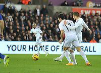 SWANSEA, WALES - JANUARY 17:   of  during the Barclays Premier League match between Swansea City and Chelsea at Liberty Stadium on January 17, 2015 in Swansea, Wales.<br /> Swansea's Gylfi Sigurdsson takes a strike on goal