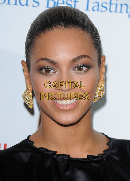 """BEYONCE KNOWLES .The Sony BMG & Sony Tri-Star's L.A. Premiere of """"Cadillac Records"""" held at The Egyptian Theatre in Hollywood, California, USA. .November 24th, 2008               .headshot portrait black gold earrings .CAP/DVS.©Debbie VanStory/Capital Pictures."""