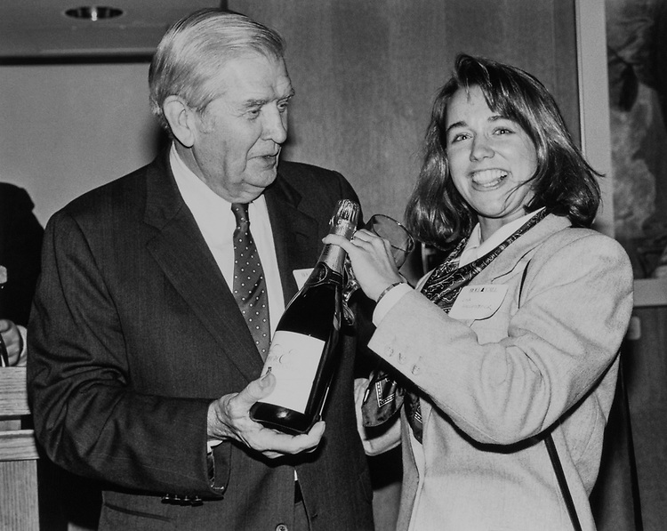 Sen. Terry Sanford, D-N.C., and Lisa Hallenbeck, (of American Security Bank) who is the 1st winner of  the Biltmore estate champaign. November 1989. (Photo by Laura Patterson/CQ Roll Call)