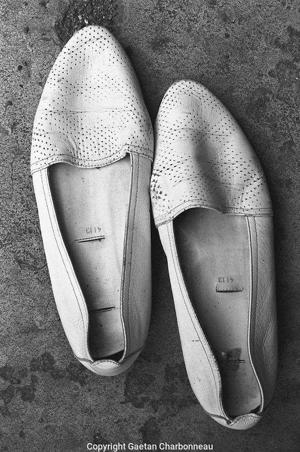 Empty pair of white shoes
