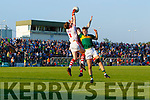 Kerry's Bryan Sweeney jumps for aerial possession against Cork keeper Ian Giltinan during the Munster U20 Football final in Austin Stack Park on Friday.