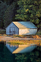 Boathouse on salt pond, Nauset Marsh, Eastham, Cape Cod, MA, Massachusetts, USA