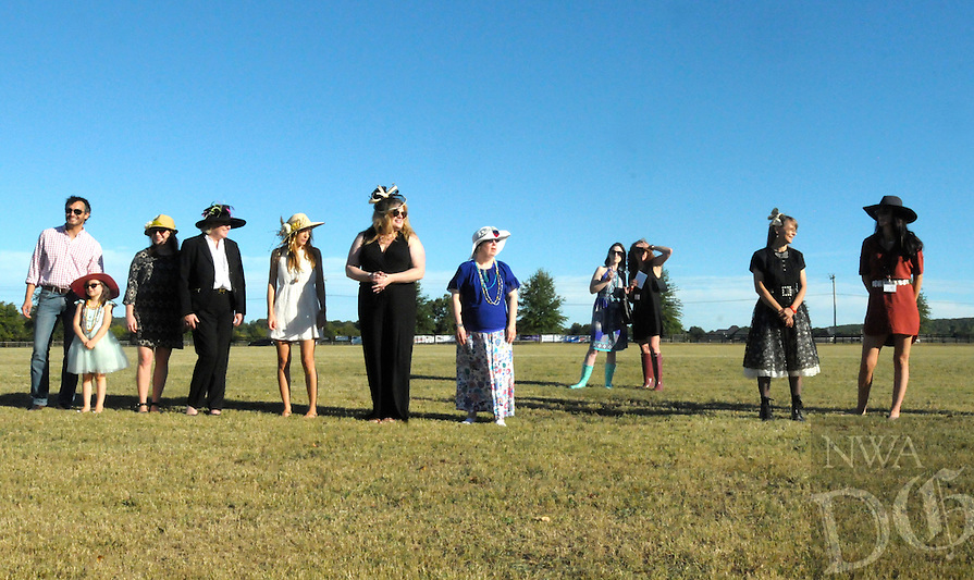 NWA Democrat-Gazette/JOCELYN MURPHY<br /> Ladies lined up on the field during halftime for the hat contest at the 27th annual Polo in the Ozarks, hosted at the Buell Farm in Fayetteville on Saturday, Sept. 10, 2016.