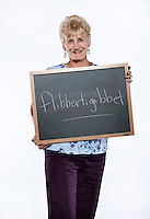 Richelle Cross (cq), from Brighton, Colorado, at the AARP National Spelling Bee for people aged 50 years and older at the Little America Hotel in Cheyenne, Wyoming, Friday, June 17, 2011. Her word, flibbertigibbet, is a Middle English word referring to a flighty or whimsical person, usually a young woman. Birthday: 02-Nov-46..Photo by Matt Nager
