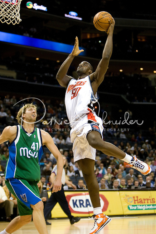 Charlotte Bobcats Emeka Okafor shoots over the Dallas Mavericks during an NBA basketball game Time Warner Cable Arena in Charlotte, NC.