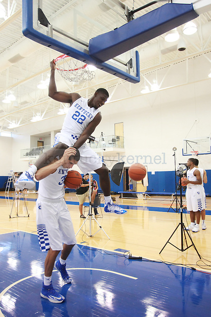 September 4, 2014-Alex Poythress and Derek Willis have fun dunking on one another in between photos at men's basketball media day at the Joe Craft Center. Photo by Emily Wuetcher | Staff