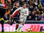 Luka Modric of Real Madrid (R) is followed by Adrian Embarba Blazquez of Rayo Vallecano during the La Liga 2018-19 match between Real Madrid and Rayo Vallencano at Estadio Santiago Bernabeu on December 15 2018 in Madrid, Spain. Photo by Diego Souto / Power Sport Images