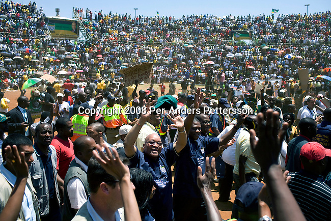 JOHANNESBURG, SOUTH AFRICA - NOVEMBER 2: Jacob Zuma, the ANC president, walks a lap with tight security as his supporters welcome him on November 2, 2008 at Jabulani stadium in Soweto, South Africa. Mr. Zuma is expected to be elected as the 3rd democratic president in the country, during the up coming elections on April 22, 2009. Mr. Zuma is extremely popular among the black people in the country and despite his many problems with facing a corruption and fraud trial, his popularity only increases. (Photo by: Per-Anders Pettersson)..